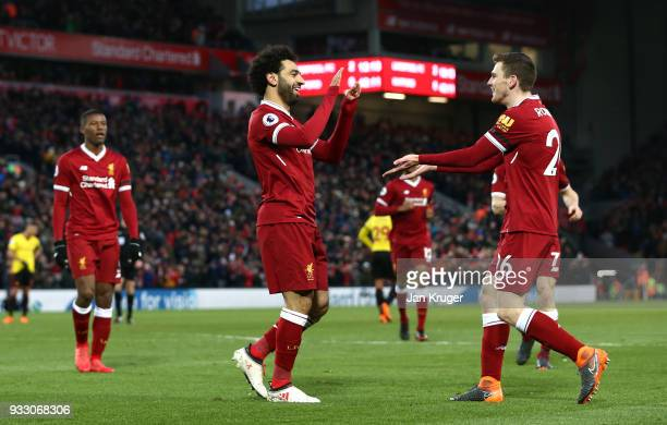 Mohamed Salah of Liverpool celebrates scoring his side's second goal with Andy Robertson during the Premier League match between Liverpool and...