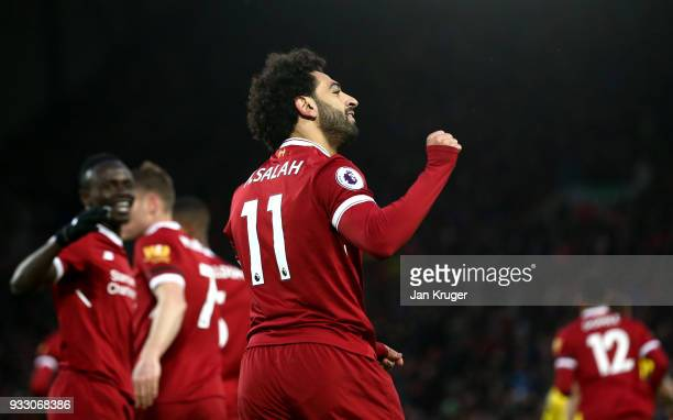 Mohamed Salah of Liverpool celebrates scoring his side's second goal during the Premier League match between Liverpool and Watford at Anfield on...