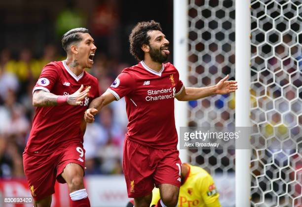 Mohamed Salah of Liverpool celebrates scoring his sides third goal with Roberto Firmino of Liverpool during the Premier League match between Watford...
