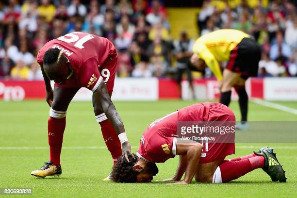 Mohamed Salah of Liverpool celebrates scoring his sides third goal with Sadio Mane of Liverpool during the Premier League match between Watford and...