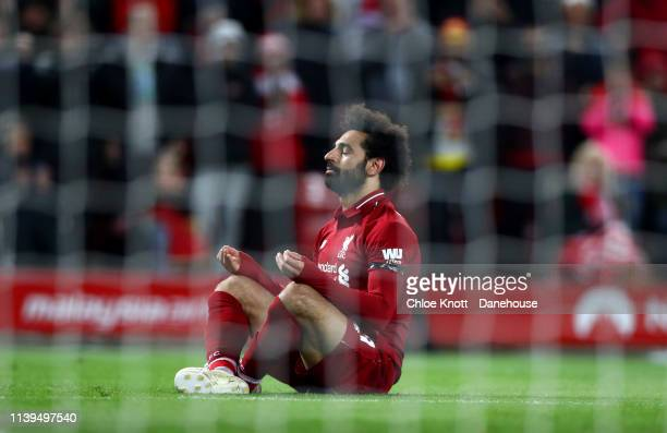 Mohamed Salah of Liverpool celebrates scoring his team's fifth goal during the Premier League match between Liverpool FC and Huddersfield Town at...