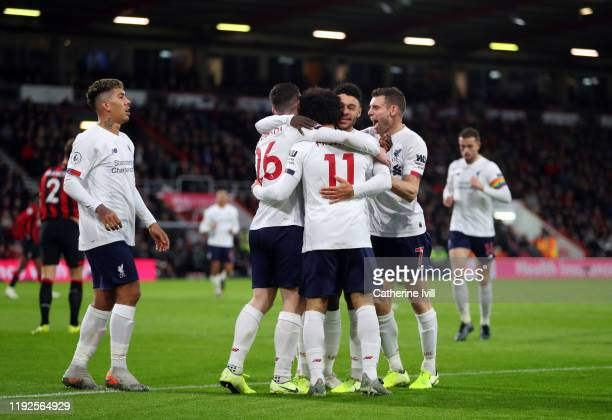 Mohamed Salah of Liverpool celebrates scoring his teams third goal with team mates during the Premier League match between AFC Bournemouth and...
