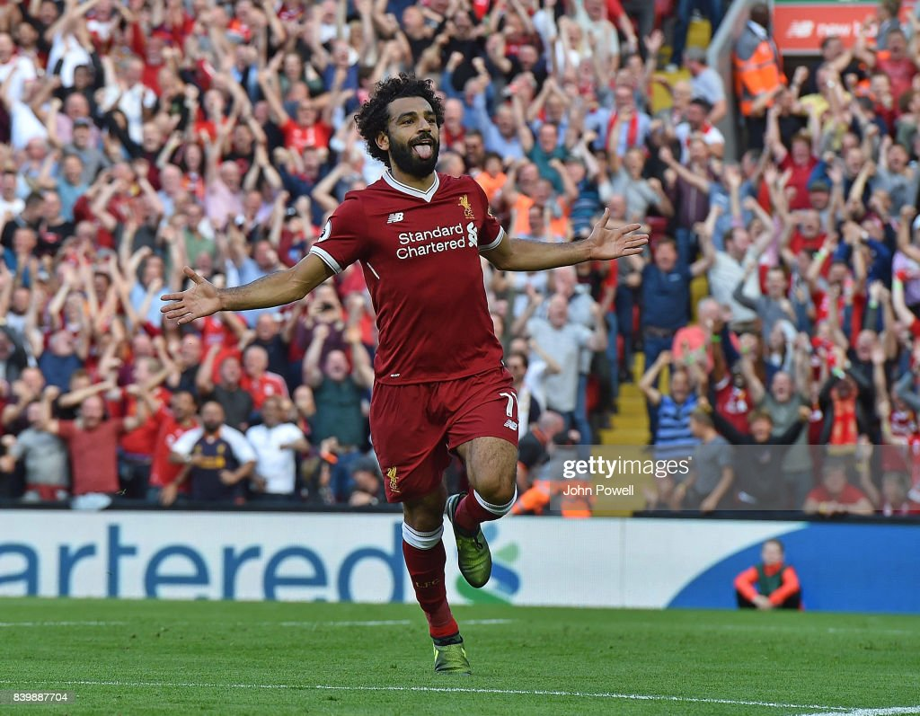 Mohamed Salah of Liverpool celebrates scoring his team's third goal during the Premier League match between Liverpool and Arsenal at Anfield on August 27, 2017 in Liverpool, England.