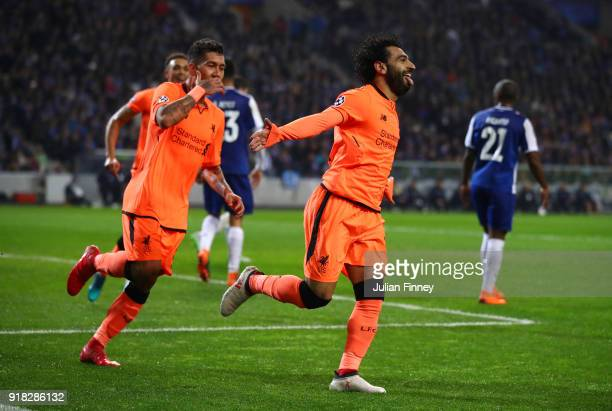 Mohamed Salah of Liverpool celebrates scoring the 2nd goal with Roberto Firmino of Liverpool during the UEFA Champions League Round of 16 First Leg...