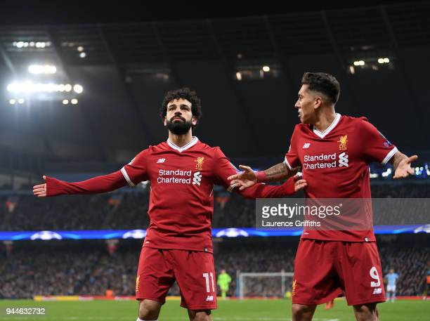 Mohamed Salah of Liverpool celebrates scoring the first goal with Roberto Firmino during the Quarter Final Second Leg match between Manchester City...