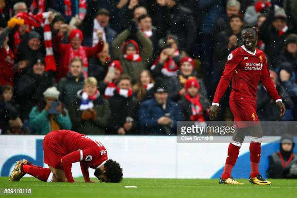 Mohamed Salah of Liverpool celebrates scoring the first Liverpool goal with Sadio Mane of Liverpool during the Premier League match between Liverpool...