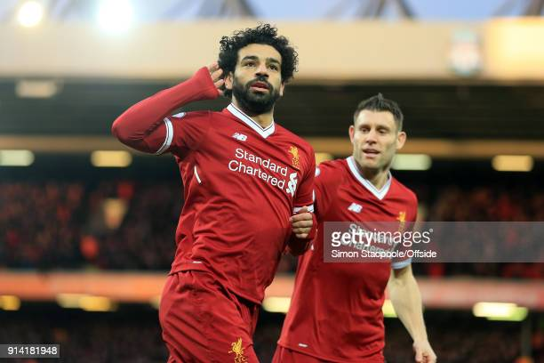 Mohamed Salah of Liverpool celebrates scoring their 1st goal during the Premier League match between Liverpool and Tottenham Hotspur at Anfield on...