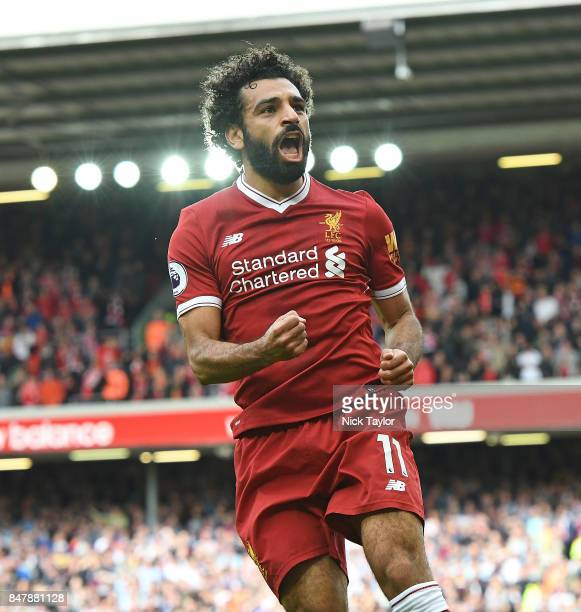Mohamed Salah of Liverpool celebrates scoring their first goal during the Premier League match between Liverpool and Burnley at Anfield on September...