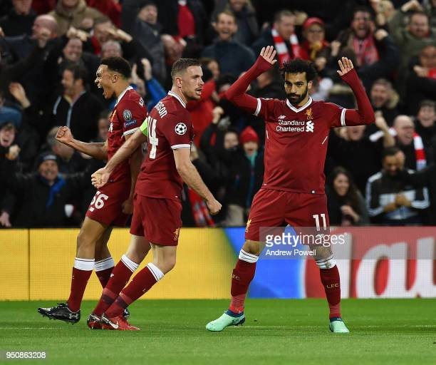 Mohamed Salah of Liverpool celebrates the first goal during the UEFA Champions League Semi Final First Leg match between Liverpool and AS Roma at...