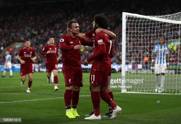 Mohamed Salah of Liverpool celebrates with Adam Lallana of Liverpool and Xherdan Shaqiri of Liverpool after scoring his sides first goal during the...