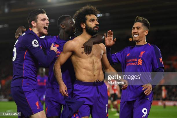 Mohamed Salah of Liverpool celebrates with Andrew Robertson, Naby Keita and Roberto Firmino during the Premier League match between Southampton FC...