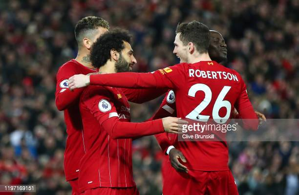 Mohamed Salah of Liverpool celebrates with Andy Robertson Sadio Mane and Roberto Firmino after scoring his team's first goal during the Premier...