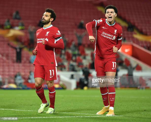 Mohamed Salah of Liverpool celebrates with Curtis Jones after scoring their team's first goal during the Premier League match between Liverpool and...
