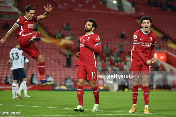 Mohamed Salah of Liverpool celebrates with Curtis Jones and Roberto Firmino after scoring their team's first goal during the Premier League match...