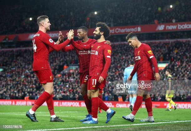 Mohamed Salah of Liverpool celebrates with Georginio Wijnaldum, Jordan Henderson and Roberto Firmino after scoring his team's third goal during the...