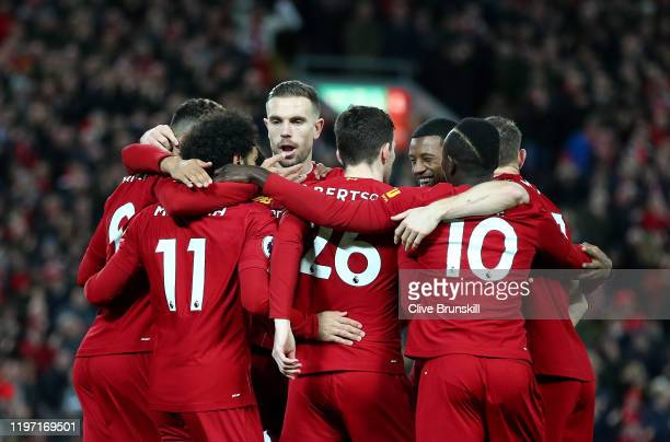 Mohamed Salah of Liverpool celebrates with his team mates after scoring his team's first goal during the Premier League match between Liverpool FC...