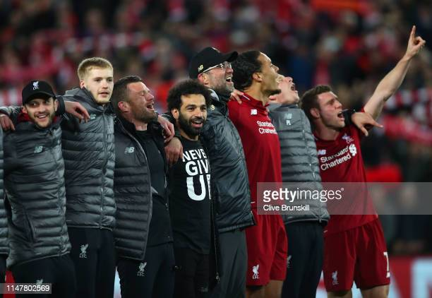 Mohamed Salah of Liverpool celebrates with his team mates wearing a shirt with the words Never Give Up after the UEFA Champions League Semi Final...