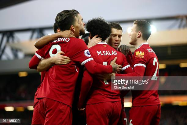 Mohamed Salah of Liverpool celebrates with his teammates after scoring his sides first goal during the Premier League match between Liverpool and...