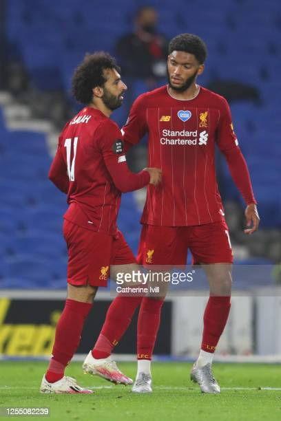 Mohamed Salah of Liverpool celebrates with Joe Gomez of Liverpool after he scores his sides third goal during the Premier League match between...