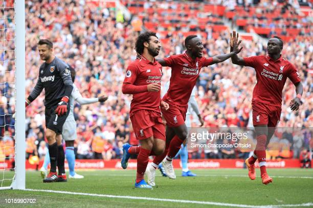 Mohamed Salah of Liverpool celebrates with Naby Keita of Liverpool and Sadio Mane of Liverpool after scoring their 1st goal during the Premier League...