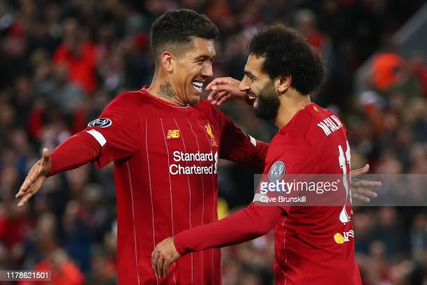 Mohamed Salah of Liverpool celebrates with Roberto Firmino after he scores his sides fourth goal during the UEFA Champions League group E match...