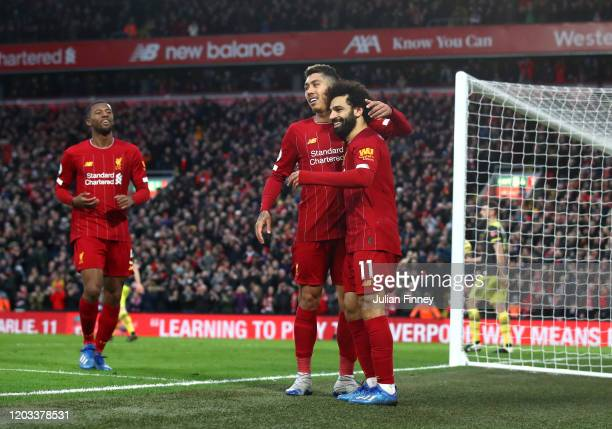 Mohamed Salah of Liverpool celebrates with Roberto Firmino after scoring his team's third goal during the Premier League match between Liverpool FC...