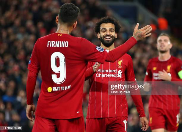 Mohamed Salah of Liverpool celebrates with Roberto Firmino of Liverpool after he scores his sides third goal during the UEFA Champions League group E...
