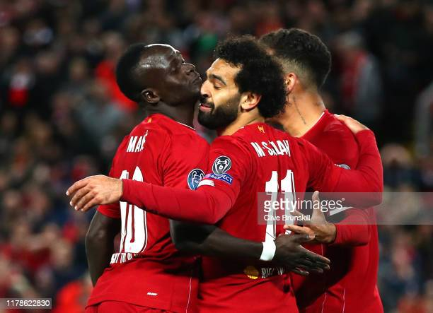 Mohamed Salah of Liverpool celebrates with Sadio Mane after he scores his sides fourth goal during the UEFA Champions League group E match between...