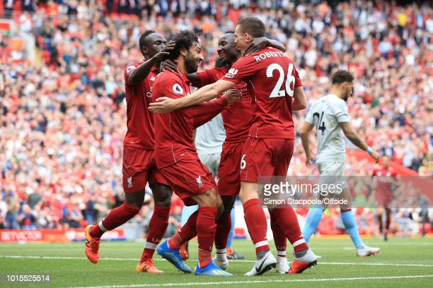 Mohamed Salah of Liverpool celebrates with Sadio Mane of Liverpool Naby Keita of Liverpool and Andrew Robertson of Liverpool after scoring their 1st...