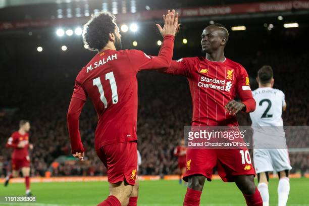 Mohamed Salah of Liverpool celebrates with Sadio Mane of Liverpool after scoring their first goal to make the score 10 during the Premier League...