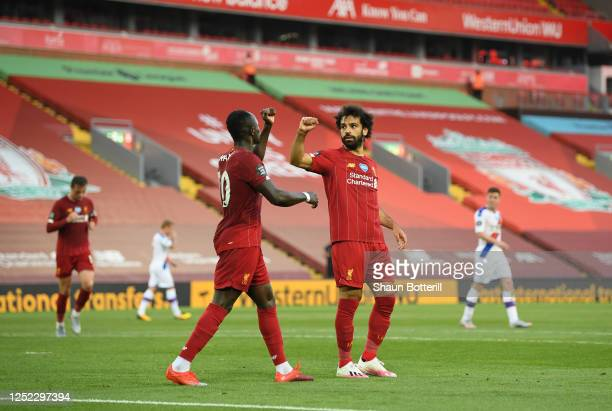 Mohamed Salah of Liverpool celebrates with Sadio Mane of Liverpool after scoring his sides second goal during the Premier League match between...