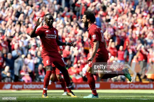 Mohamed Salah of Liverpool celebrates with Sadio Mane of Liverpool after scoring his sides first goal during the Premier League match between...
