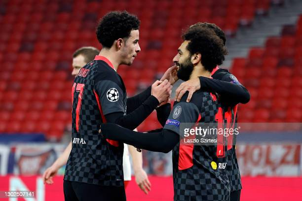 Mohamed Salah of Liverpool celebrates with team mate Curtis Jones after scoring their side's first goal during the UEFA Champions League Round of 16...