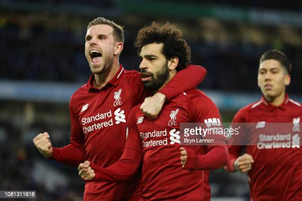 Mohamed Salah of Liverpool celebrates with team mate Jordan Henderason of Liverpool after scoring their first goal from the penalty spot during the...