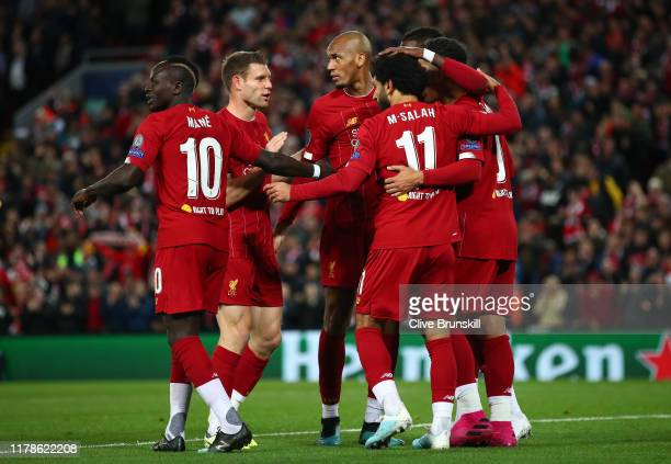 Mohamed Salah of Liverpool celebrates with team mates after he scores his sides fourth goal during the UEFA Champions League group E match between...