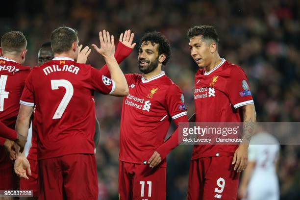 Mohamed Salah of Liverpool celebrates with team mates after Sadio Mane of Liverpool scores their third goal during the UEFA Champions League Semi...