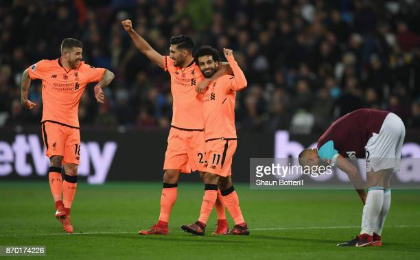 Mohamed Salah of Liverpool celebrates with team mates after scoring his sides fourth goal during the Premier League match between West Ham United and...