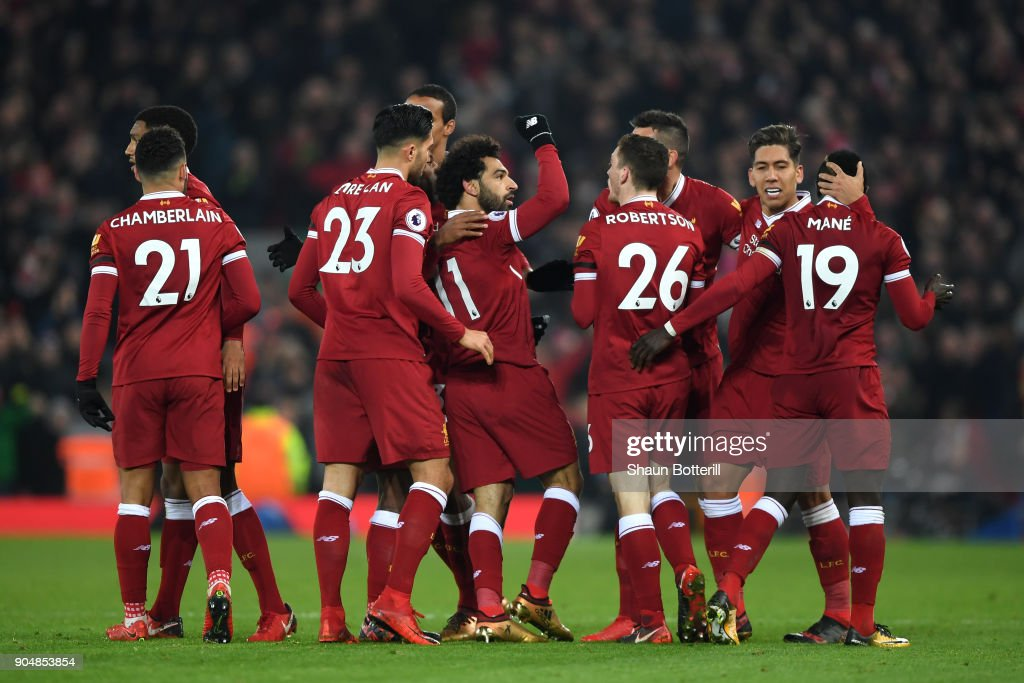 Mohamed Salah of Liverpool celebrates with team mates after scoring the fourth Liverpool goal during the Premier League match between Liverpool and Manchester City at Anfield on January 14, 2018 in Liverpool, England.