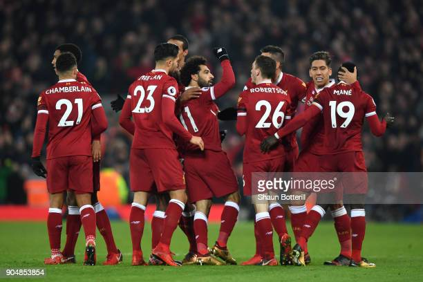 Mohamed Salah of Liverpool celebrates with team mates after scoring the fourth Liverpool goal during the Premier League match between Liverpool and...