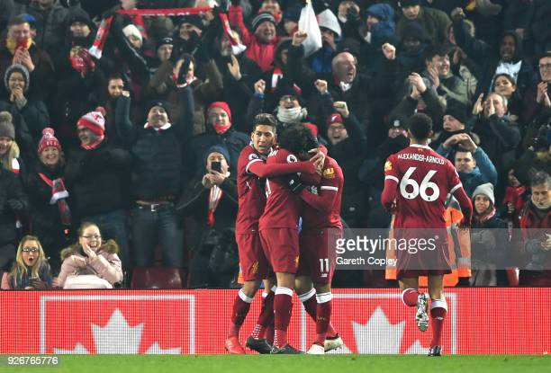 LIVERPOOL ENGLAND MARCH 03 Mohamed Salah of Liverpool celebrates with team mates after scoring his sides first goal during the Premier League match...