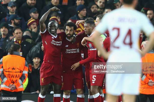 Mohamed Salah of Liverpool celebrates with team mates after scoring his second goal during the UEFA Champions League Semi Final First Leg match...