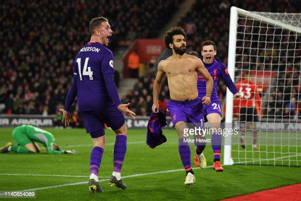 Mohamed Salah of Liverpool celebrates with team mates Andy Robertson of Liverpool and Jordan Henderson of Liverpool after scoring their team's second...