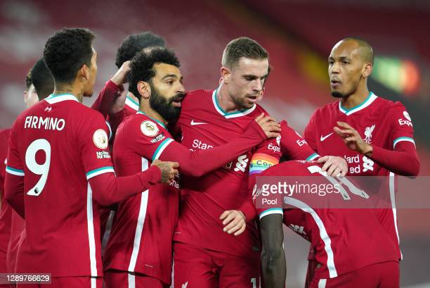 Mohamed Salah of Liverpool celebrates with team mates Jordan Henderson , Roberto Firminho and Fabinho after scoring their sides first goal during the...