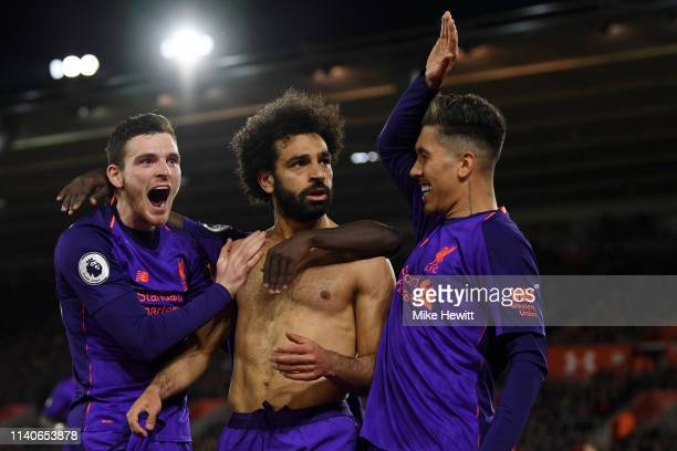 Mohamed Salah of Liverpool celebrates with team mates Roberto Firmino of Liverpool and Andy Robertson of Liverpool after scoring their team's second...