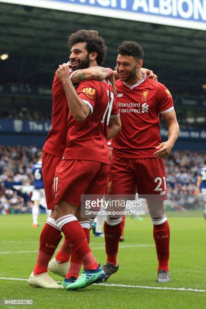 Mohamed Salah of Liverpool celebrates with teammate Alex OxladeChamberlain of Liverpool after scoring their 2nd goal during the Premier League match...