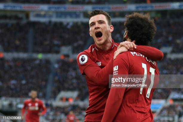 Mohamed Salah of Liverpool celebrates with teammate Andrew Robertson of Liverpool after scoring their 2nd goal during the Premier League match...