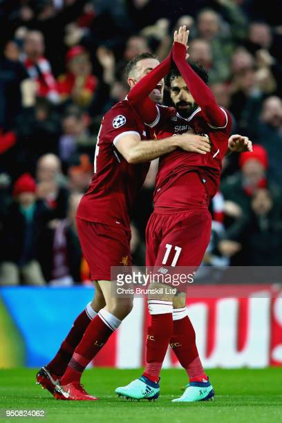 Mohamed Salah of Liverpool celebrates with teammate Jordan Henderson after scoring his sides first goal during the UEFA Champions League Semi Final...