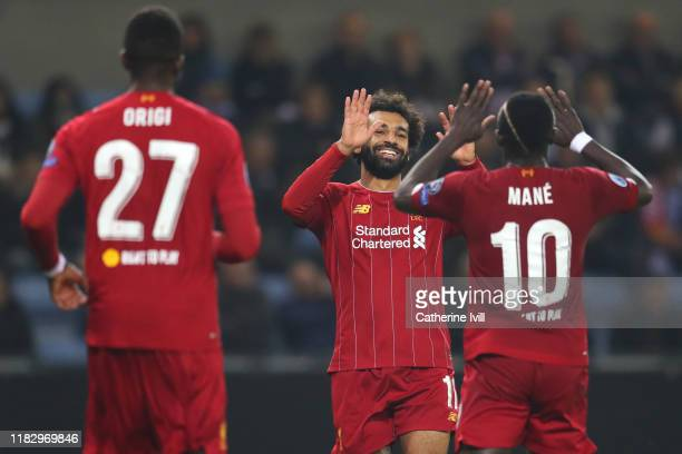 Mohamed Salah of Liverpool celebrates with teammate Sadio Mane after scoring his team's fourth goal during the UEFA Champions League group E match...