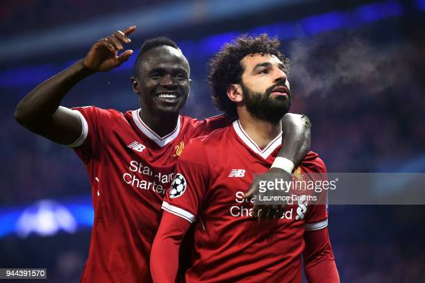 Mohamed Salah of Liverpool celebrates with teammate Sadio Mane after scoring his sides first goal during the UEFA Champions League Quarter Final...