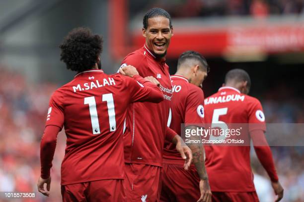 Mohamed Salah of Liverpool celebrates with teammate Virgil van Dijk of Liverpool after scoring their 1st goal during the Premier League match between...